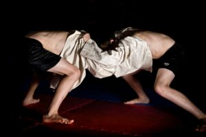 Locked in, brothers Luke and Jamie Hannaford. Cornish Wrestling demonstration at Landithy Hall, Madron.